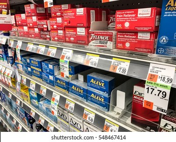 New York, December 15, 2016: Drug store shelf is seen filled with tylenol, aleve and other pain relievers.