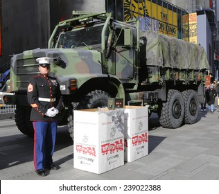 NEW YORK - DECEMBER 18: U. S. Marine during U.S Marine Corps Reserve Toys for Tots Program collection at the Times Square on December 18, 2014 in midtown Manhattan.