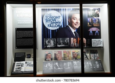 NEW YORK - DECEMBER 19, 2017: Window display decorated with The Tonight Show with Jimmy Fallon logo in Rockefeller Center in Midtown Manhattan