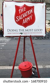 NEW YORK - DECEMBER 19  Salvation Army red kettle for collections on December 19, 2013 in midtown Manhattan  This Christian organization is known for its charity work, operating in 126 countries