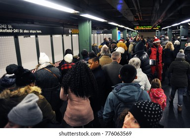 NEW YORK, NEW YORK - DECEMBER 2017: Crowds form at a subway station in Times Square in New York City.