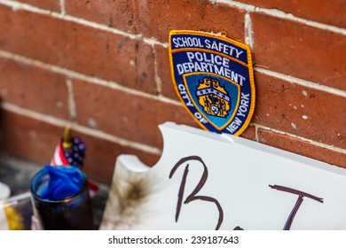 NEW YORK - DECEMBER 21: People and memorial at spot where Officer Wenjian Liu and Officer Rafael Ramos were murdered at about 2:47 p.m. on December 20th 2014 outside 98 Tompkins Ave in Brooklyn, NY by