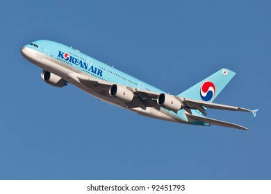 NEW YORK - DECEMBER 21:A380 Korean Air climbs after takeoff for JFK  in New York, USA on December 21, 2011Blue top livery was introduced on in 1984 A380 is the biggest passenger plane in the world