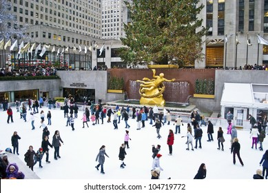 NEW YORK - DECEMBER 26: Ice skaters and tourists are all around the famous Rockefeller Center Christmas tree on December 26, 2011 in  New York City.