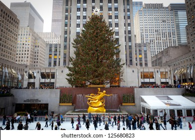 NEW YORK - DECEMBER 26: The Rockefeller Center Christmas Tree and statue of Prometheus above the ice rink on December 26 2012 in Manhattan New York. Rockefeller Center is a National Historic Landmark