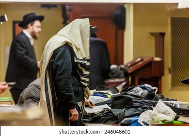 NEW YORK - DECEMBER 26: Ultra Orthodox Jewish man praying during service in the famous 770 Chabad Lubavitch headquarter and home to last Chabad leader Menachem Mendel Schneerson on December 26 2014