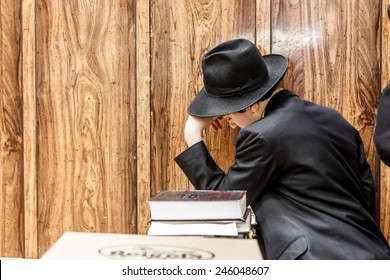NEW YORK - DECEMBER 26: Ultra Orthodox Jewish man studying scriptures in the famous 770 Chabad Lubavitch headquarter and home to last Chabad leader Menachem Mendel Schneerson on December 26 2014