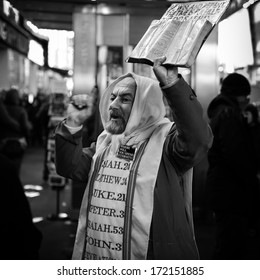 NEW YORK - DECEMBER 27, 2012: A christian preacher, holding the Bible in one hand, warns the tourists of the Apocalypse to come. This prophet sends tirelessly the same message for more than 10 years