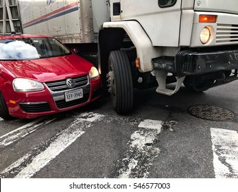 New York, December 30, 2016: Scene of a car accident involving a Volkswagen sedan and a US Mail truck. The truck driver was unaware of the car by his truck's right side making the same turn.