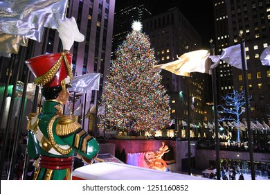 NEW YORK - DECEMBER 4, 2018: A Large toy nutcracker drummer statue and the holiday lights in Rockefeller Centr on December 4, at New York City, NY.