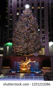 NEW YORK - DECEMBER 4, 2018: The famous Rockefeller Center Christmas Tree and Prometheus Statue at Rockefeller Center on December 4, at New York City, NY.