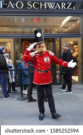 NEW YORK - DECEMBER 5, 2019: A doormen dressed as a toy soldier stand outside reopened the FAO Schwarz flagship store at Rockefeller Plaza in Midtown Manhattan