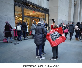 NEW YORK - DECEMBER 5, 2019: Tourists outside of reopened the FAO Schwarz flagship store at Rockefeller Plaza in Midtown Manhattan