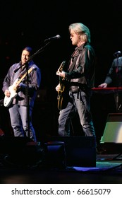 NEW YORK - DECEMBER 5: Singer Daryl Hall (R) of music group Hall & Oates performs at the Beacon Theatre on December 5, 2010 in New York City.