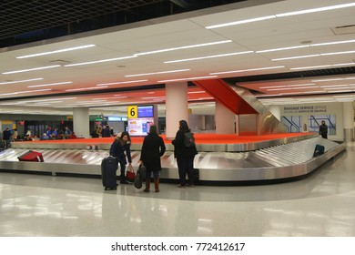 NEW YORK- DECEMBER 6, 2017: Baggage carousel in JetBlue Terminal 5 at JFK International Airport in New York. JFK is one of the biggest airports in the world with 4 runways and 8 terminals