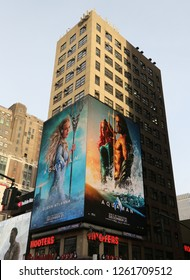NEW YORK - DECEMBER 6, 2018: Billboard promoting new Aquaman superhero film based on the DC Comics character of the same name, distributed by Warner Bros in Manhattan