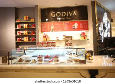 NEW YORK - DECEMBER 6, 2018: Godiva store in Macy's Herald Square in Manhattan. Godiva Chocolatier is a manufacturer of premium chocolates founded in Belgium in 1926.