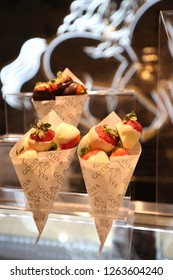 NEW YORK - DECEMBER 6, 2018: Chocolate Dipped Strawberries by Godiva on display in Macy's Herald Square. Godiva Chocolatier is a manufacturer of premium chocolates founded in Belgium in 1926