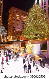NEW YORK - DECEMBER 8, 2015: Locals and visitors skate under the Rockefeller Center Christmas tree in New York City on December 8, 2015