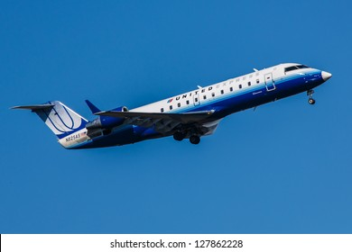 NEW YORK - DECEMBER 9:Embraer 145 United Airline on final to JFK airport located in New York, USA on December 9, 2012  United Airlines, a major U.S. airline, was founded in 1926