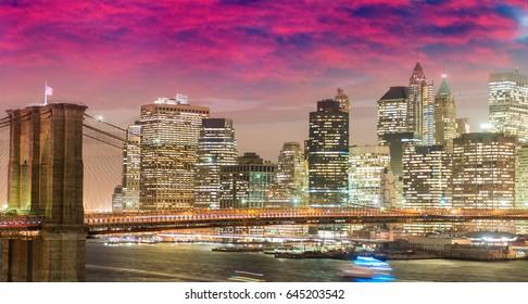 New York at dusk. Awesome view of Brooklyn Bridge from Manhattan Bridge.