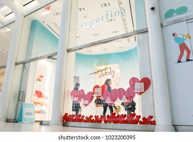 New York, Feb 9, 2018: Young man and woman are seen browsing a Sugarfina store.