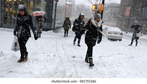NEW YORK - FEB 9: Pedestrians walk along Astor Place on February 9, 2017 in New York. Approximately six inches of snow fell in and around NYC.