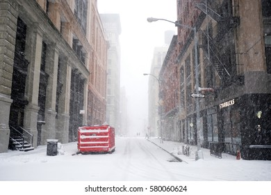 NEW YORK - FEB 9: View of Mercer Street as snow falls on February 9, 2017 in New York. Snowfall totals of approximately six inches fell in and around NYC.