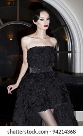 NEW YORK - FEBRUARY 02: A model shows evening wear for Marusya collection by Marina Ilchenko at Peninsula hotel in Manhattan on February 02, 2012 in New York.