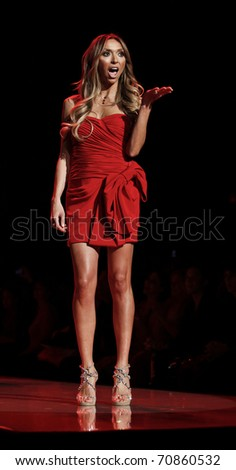 9d3d6d2f249 NEW YORK - FEBRUARY 09: Giuliana Rancic in Notte by Marchesa dress walks  runway for