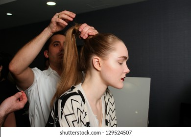 NEW YORK - FEBRUARY 10: A model gets ready backstage for Victor de Souza collection at the Strand hotel during Mercedes-Benz Fashion Week on February 10, 2013 in New York City