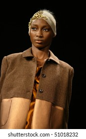 NEW YORK - FEBRUARY 11: A model is walking the runway at the Ports 1961 Collection for Fall/Winter 2010 during Mercedes-Benz Fashion Week on February 11, 2010 in New York.
