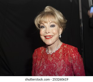 NEW YORK - FEBRUARY 12, 2015: Barbara Eden prepares backstage for the Heart Truth Red Dress Collection 2015 fashion show as part of Fall 2015 Mercedez-Benz Fashion Week at Lincoln Center