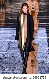 NEW YORK, NEW YORK - FEBRUARY 13: A model walks the runway during the BOSS Womenswear & Menswear runway show on February 13, 2019 in NYC