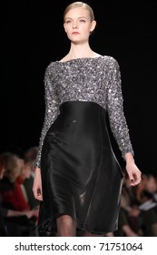 NEW YORK - FEBRUARY 14: Model Nimue Smit walks the runway at the Carolina Herrera Fall 2011 Collection presentation during Mercedes-Benz Fashion Week on February 14, 2011 in New York.