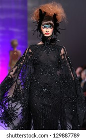 NEW YORK - FEBRUARY 15:  A Model walks on the Catalin Botezatu fashion runway at The New Yorker Hotel during Couture Fashion Week on February 15, 2013 in New York City