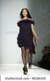 NEW YORK - FEBRUARY 15: A model is walking the runway at the TADASHI SHOJI Collection for Fall/Winter 2010 during Mercedes-Benz Fashion Week on February 15, 2010 in New York.