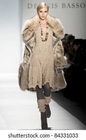 NEW YORK - FEBRUARY 15: A model walks the runway at the Dennis Basso Collection presentation for Fall/Winter 2011 during Mercedes-Benz Fashion Week on February 15, 2011 in New York.