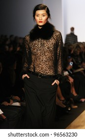 NEW YORK - FEBRUARY 15: Model Ming Xi walks the runway at the Michael Kors FW 2012 collection presentation during Mercedes-Benz Fashion Week on February 15, 2012 in New York.
