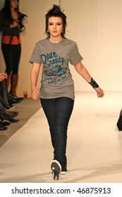 NEW YORK - FEBRUARY 16: A model walks the runway at the Clandestine Industries by Pete Wentz fashion show on February 16, 2010 in NYC