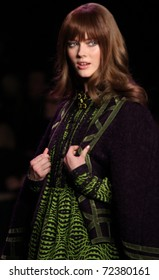 NEW YORK - FEBRUARY 16: Model Jac Jagaciack walks the runway at the Anna Sui Fall 2011 Collection presentation during Mercedes-Benz Fashion Week on February 16, 2011 in New York.