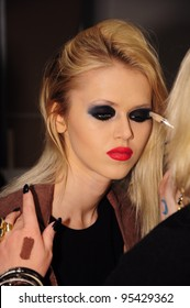 NEW YORK - FEBRUARY 16: A Model getting ready for Stephen Burrows Fall/Winter 2012 presentation at Audi Forum during New York Fashion Week on February 16, 2012 in NYC.