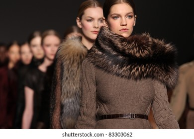 NEW YORK - FEBRUARY 16: Models walk the runway at the Elie Tahari Fall 2011 Collection Presentation during Mercedes-Benz Fashion Week on February 16, 2011 in New York.