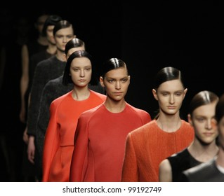 NEW YORK - FEBRUARY 16: Models walk the runway at the Calvin Klein FW 2012 collection presentation during Mercedes-Benz Fashion Week on February 16, 2012 in New York.