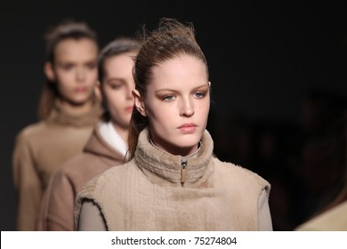 NEW YORK - FEBRUARY 17: Models walk the runway at the Calvin Klein Fall 2011 Collection presentation during Mercedes-Benz Fashion Week on February 17, 2011 in New York.