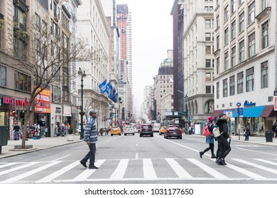 New York - February 19, 2018: A view down a busy avenue street, People walk on busy streets