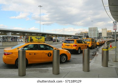 NEW YORK- FEBRUARY 2, 2017: NYC taxi at Delta Airline Terminal 4 at JFK International Airport in New York. JFK is one of the biggest airports in the world with 4 runways and 8 terminals