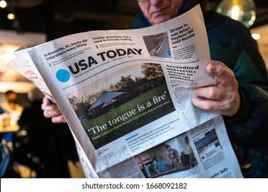 NEW YORK - FEBRUARY, 2020: Man reading USA Today newspaper.