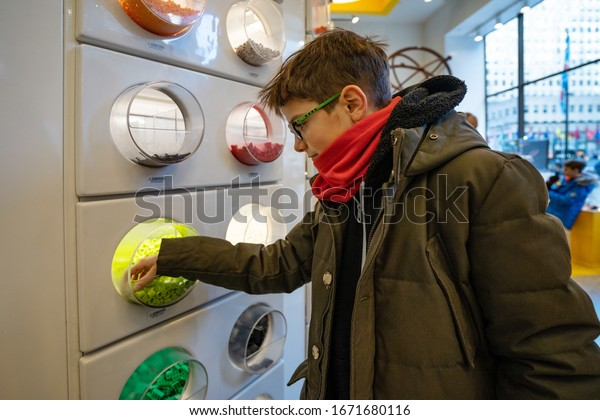 NEW YORK - FEBRUARY, 2020: Young boy inside Lego store in Manhattan. Lego is a popular line of construction toys popular with kids and collectors worldwide.