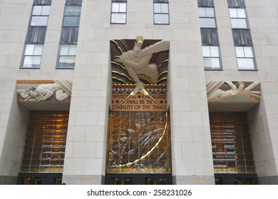 NEW YORK - FEBRUARY 26, 2015: Wisdom, an art deco frieze by Lee Lawrie over the entrance of GE Building at Rockefeller plaza